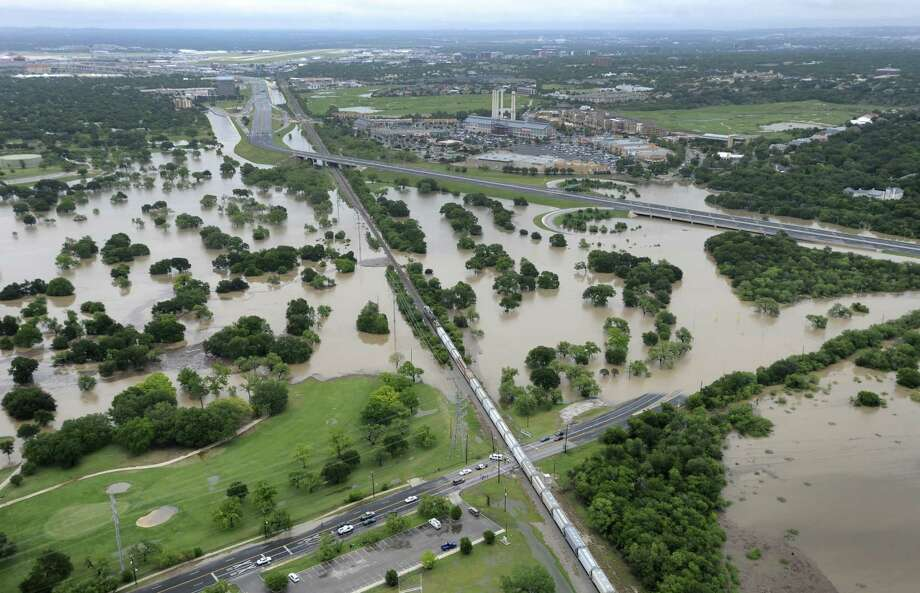 The Olmos Basin Municipal Golf Course and a section of Basse Road are underwater as a result of the heavy rainfall that inundated the city. Photo: Billy Calzada / San Antonio Express-News
