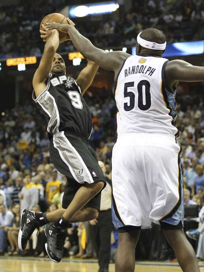 The Spurs' Tony Parker (9) takes a shot against the Grizzlies' Zach Randolph (50) in overtime of Game 3 of the 2013 Western Conference Finals at the FedEx Forum in Memphis on Saturday, May 25, 2013. Spurs defeated the Grizzlies, 104-93, in overtime. (Kin Man Hui / San Antonio Express-News)