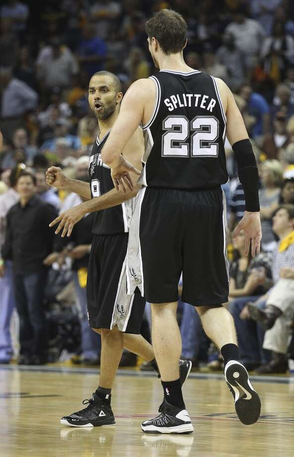 The Spurs' Tony Parker (9) reacts after scoring on a foul against the Grizzlies in overtime of Game 3 of the 2013 Western Conference Finals at the FedEx Forum in Memphis on Saturday, May 25, 2013. Spurs defeated the Grizzlies, 104-93, in overtime. (Kin Man Hui / San Antonio Express-News)