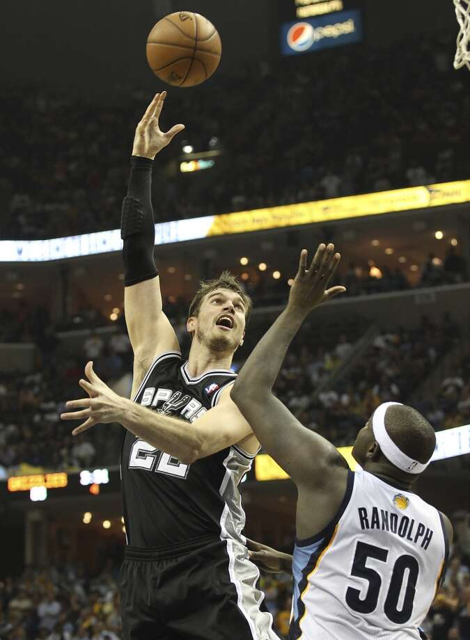 The Spurs' Tiago Splitter (22) shoots over the Grizzlies' Zach Randolph (50) in Game 3 of the 2013 Western Conference Finals at the FedEx Forum in Memphis on Saturday, May 25, 2013. Spurs defeated the Grizzlies, 104-93, in overtime.  (Kin Man Hui / San Antonio Express-News)