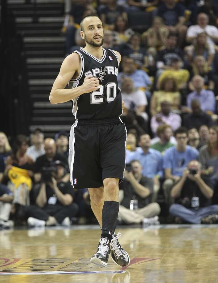The Spurs' Manu Ginobili (20) skips backwards after sinking a 3-pointer against the Grizzlies in Game 3 of the 2013 Western Conference Finals at the FedEx Forum in Memphis on Saturday, May 25, 2013. Spurs defeated the Grizzlies, 104-93, in overtime. (Kin Man Hui / San Antonio Express-News)