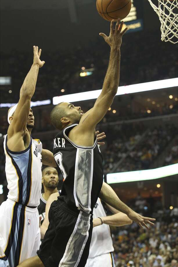 The Spurs' Tony Parker (9) rolls a shot off his fingers against Memphis Grizzlies' Jerryd Bayless (7) in Game 3 of the 2013 Western Conference Finals at the FedEx Forum in Memphis on Saturday, May 25, 2013. Spurs defeated the Grizzlies, 104-93, in overtime. (Kin Man Hui / San Antonio Express-News)