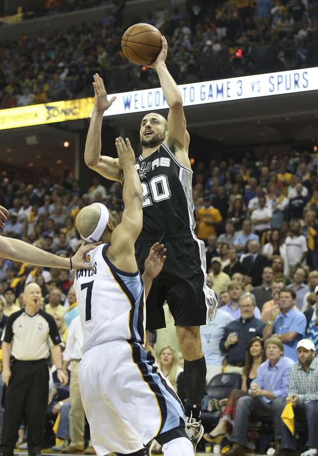 The Spurs' Manu Ginobili (20) shoots against the Grizzlies' Jerryd Bayless (7) in Game 3 of the 2013 Western Conference Finals at the FedEx Forum in Memphis on Saturday, May 25, 2013. Spurs defeated the Grizzlies, 104-93, in overtime. (Kin Man Hui / San Antonio Express-News)