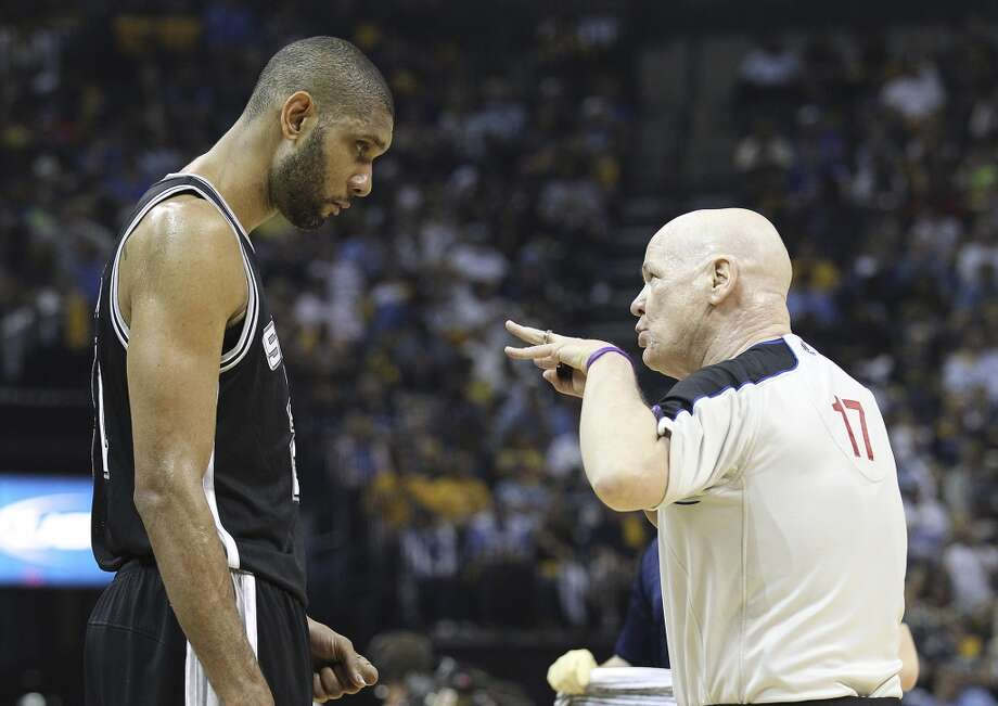 The Spurs' Tim Duncan (21) listens to game official Joe Crawford during a timeout in the game against the Grizzlies in Game 3 of the 2013 Western Conference Finals at the FedEx Forum in Memphis on Saturday, May 25, 2013. Spurs defeated the Grizzlies, 104-93, in overtime. (Kin Man Hui / San Antonio Express-News)