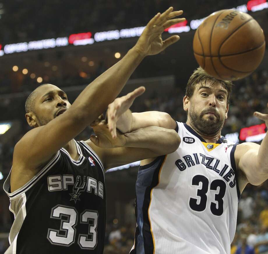 The Spurs' Boris Diaw (33) battles for a rebound against the Grizzlies' Marc Gasol (33) in Game 3 of the 2013 Western Conference Finals at the FedEx Forum in Memphis on Saturday, May 25, 2013. Spurs defeated the Grizzlies, 104-93, in overtime.  (Kin Man Hui / San Antonio Express-News)