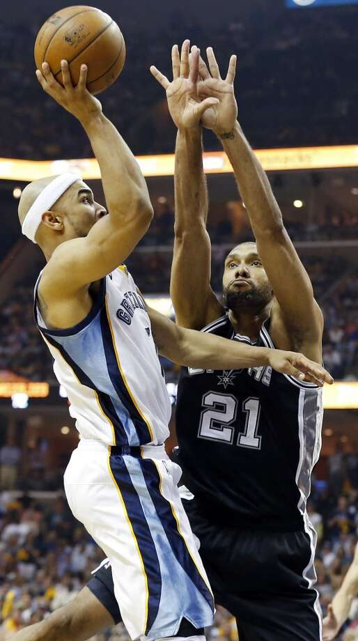 The Spurs' Tim Duncan defends the Grizzlies' Jerryd Bayless during second half action in Game 3 of the 2013 Western Conference finals Saturday, May 25, 2013 at the FedEx Forum in Memphis, Tenn. The Spurs won 104-93 in overtime. (Edward A. Ornelas / San Antonio Express-News)