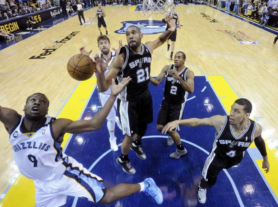 The Spurs' Tim Duncan, Kawhi Leonard and Danny Green grab for a rebound against the Grizzlies' Tony Allen as the Grizzlies' Marc Gasol looks on during Game 3 of the 2013 Western Conference finals Saturday, May 25, 2013 at the FedEx Forum in Memphis, Tenn. The Spurs won 104-93 in overtime. (Edward A. Ornelas / San Antonio Express-News)