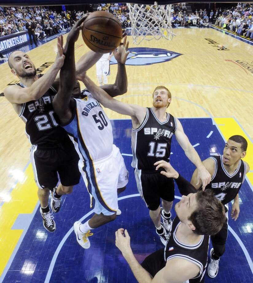 The Spurs' Manu Ginobili, Matt Bonner, Danny Green, and  Tiago Splitter grab for a rebound against the Grizzlies' Zach Randolph during Game 3 of the 2013 Western Conference finals Saturday, May 25, 2013 at the FedEx Forum in Memphis, Tenn. The Spurs won 104-93 in overtime. (Edward A. Ornelas / San Antonio Express-News)
