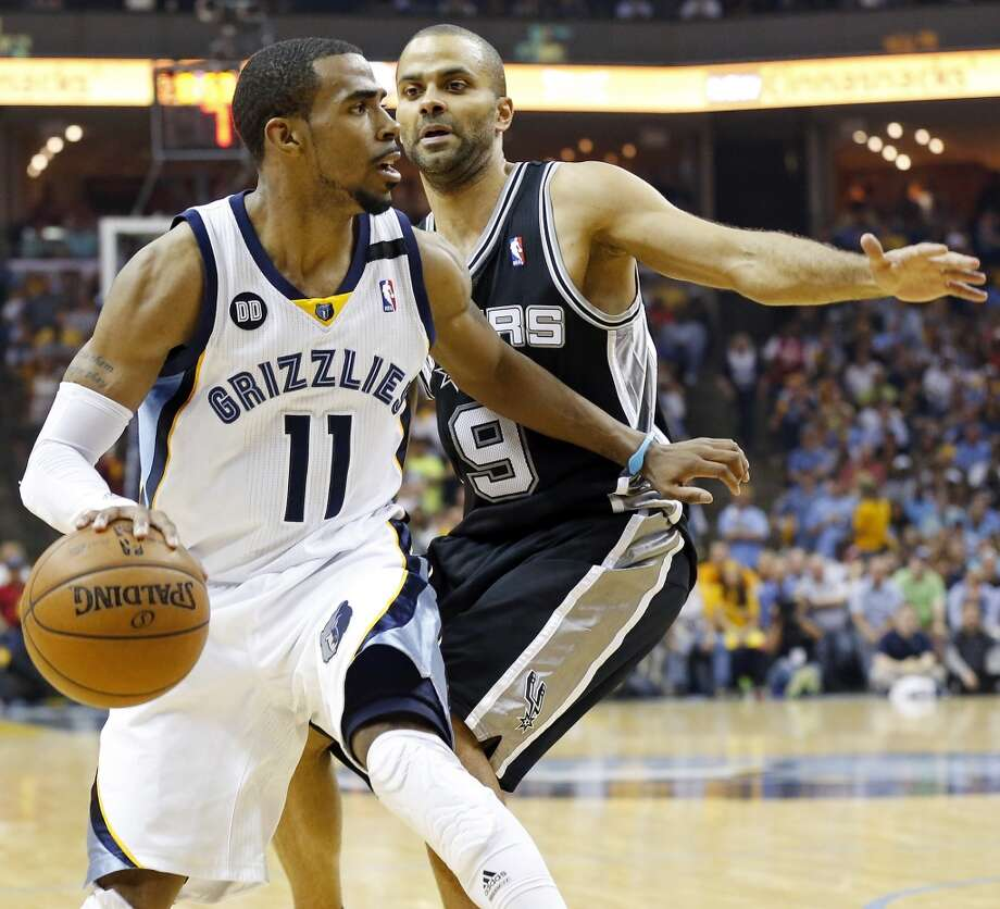 The Grizzlies' Mike Conley looks for room around the Spurs' Tony Parker during second half action in Game 3 of the 2013 Western Conference finals Saturday, May 25, 2013 at the FedEx Forum in Memphis, Tenn. The Spurs won 104-93 in overtime. (Edward A. Ornelas / San Antonio Express-News)