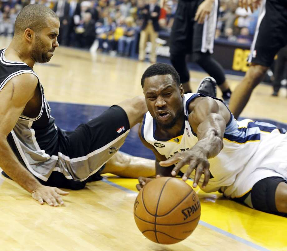 The Spurs' Tony Parker and Grizzlies' Tony Allen grab for a loose ball during second half action in Game 3 of the 2013 Western Conference finals Saturday, May 25, 2013 at the FedEx Forum in Memphis, Tenn. The Spurs won 104-93 in overtime. (Edward A. Ornelas / San Antonio Express-News)