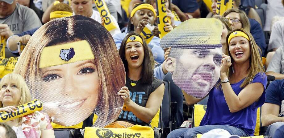 Grizzlies fans hold cutouts of Eva Longoria and Tony Parker before Game 3 of the 2013 Western Conference finals against the Spurs on Saturday, May 25, 2013 at the FedEx Forum in Memphis, Tenn. (Edward A. Ornelas / San Antonio Express-News)