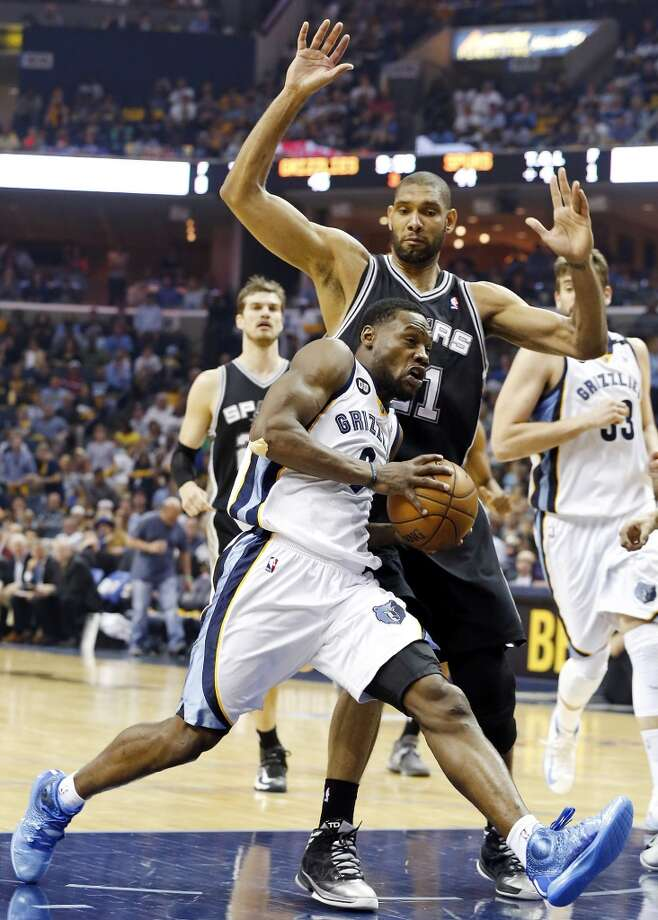 The Spurs' Tim Duncan defends the Grizzlies' Tony Allen during second half action in Game 3 of the 2013 Western Conference finals Saturday, May 25, 2013 at the FedEx Forum in Memphis, Tenn. The Spurs won 104-93 in overtime. (Edward A. Ornelas / San Antonio Express-News)
