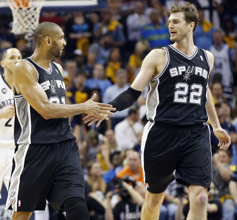 The Spurs' Tim Duncan and Tiago Splitter celebrate after Splitter scored during overtime action in Game 3 of the 2013 Western Conference finals against the Grizzlies on Saturday, May 25, 2013 at the FedEx Forum in Memphis, Tenn. The Spurs won 104-93 in overtime. (Edward A. Ornelas / San Antonio Express-News)