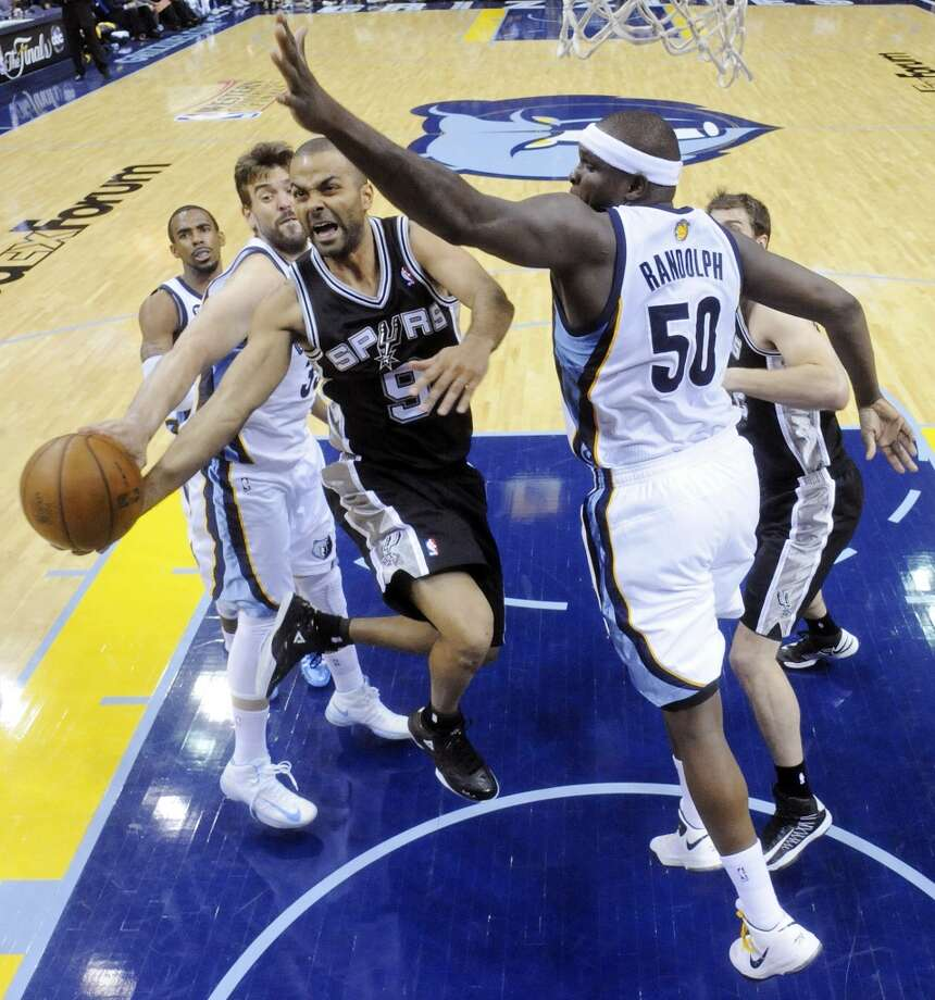 San Antonio Spurs' Tony Parker drives between Memphis Grizzlies' Marc Gasol and Memphis Grizzlies' Zach Randolph during Game 3 of the 2013 Western Conference finals Saturday May 25, 2013 at the FedEx Forum in Memphis, Tenn. The Spurs won 104-93 in overtime. (Edward A. Ornelas / San Antonio Express-News)