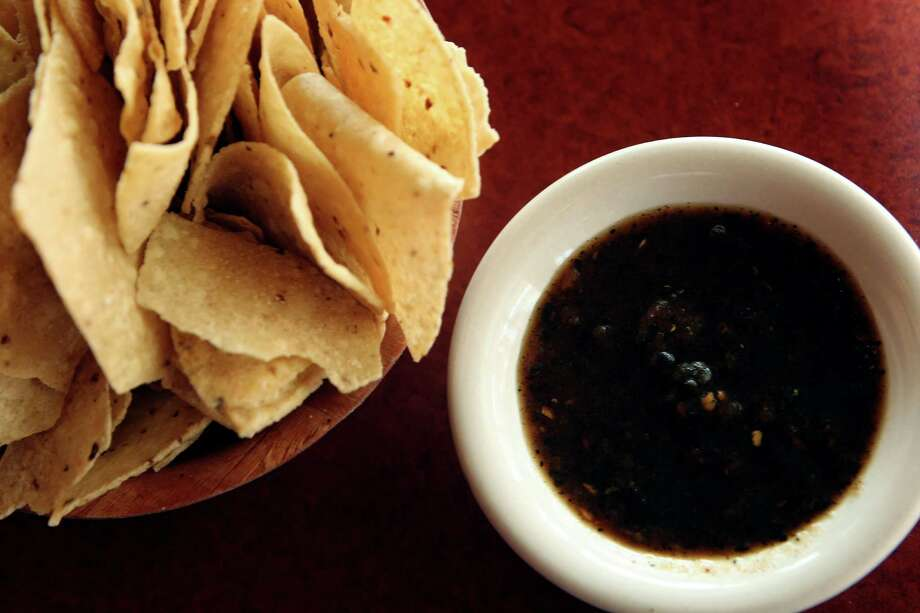 DARK AND RIVETINGThe restaurant: Rosario's, 910 S. Alamo St. at South St. Mary's StreetThe salsa: Roasted redWhy we love it: Rosario's has kept its salsa consistent from the time the restaurant opened in its original location a short distance away. The sturdy salsa is a deep, rich reddish brown with just the right amount of salt, and is perfect for dipping or adding to dishes. Photo: Helen L. Montoya, San Antonio Express-News / ©SAN ANTONIO EXPRESS-NEWS