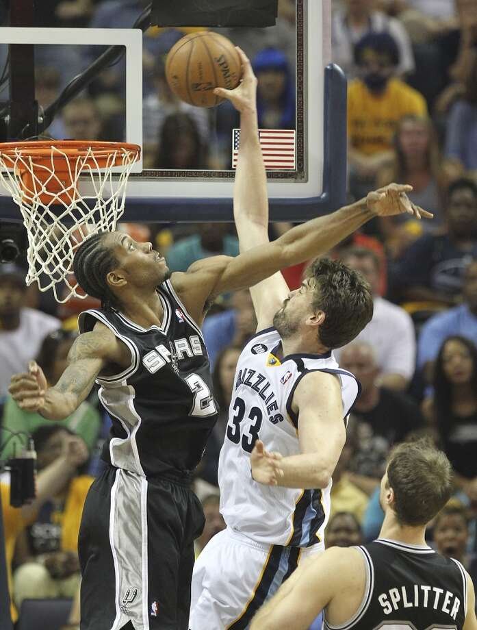 The Spurs' Kawhi Leonard (2) misses a block on a dunk by Grizzlies' Marc Gasol (33) in Game 3 of the 2013 Western Conference Finals at the FedEx Forum in Memphis on Saturday, May 25, 2013. Spurs defeated the Grizzlies, 104-93, in overtime. (Kin Man Hui / San Antonio Express-News)