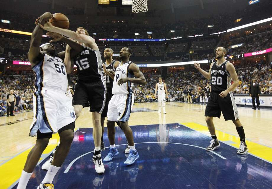 The Spurs' Matt Bonner (15) fouls the Grizzlies' Zach Randolph (50) in Game 3 of the 2013 Western Conference Finals at the FedEx Forum in Memphis on Saturday, May 25, 2013. Spurs defeated the Grizzlies, 104-93, in overtime. (Kin Man Hui / San Antonio Express-News)