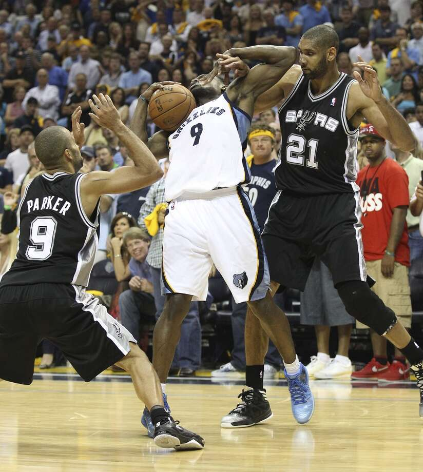 The Spurs' Tim Duncan (21) and Tony Parker (9) defend against the Grizzlies' Tony Allen (9) in Game 3 of the 2013 Western Conference Finals at the FedEx Forum in Memphis on Saturday, May 25, 2013. Spurs defeated the Grizzlies, 104-93, in overtime. (Kin Man Hui / San Antonio Express-News)