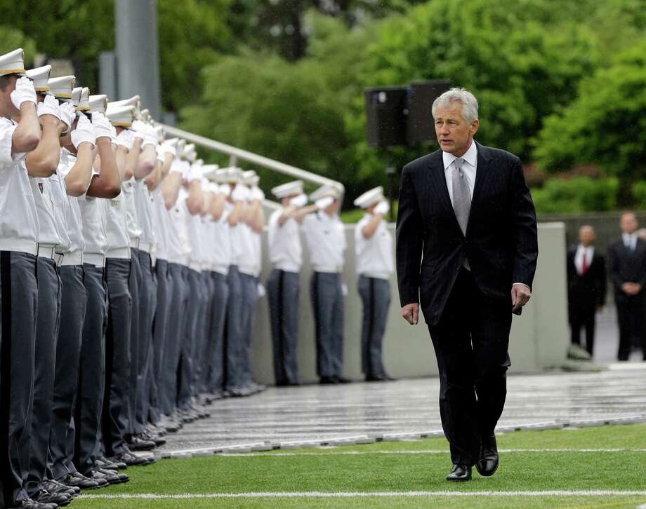 Defense Secretary Chuck Hagel arrives for a graduation and commissioning ceremony at the U.S. Military Academy, Saturday, May 25, 2013, in West Point, N.Y. (AP Photo/Mike Groll) Photo: Mike Groll