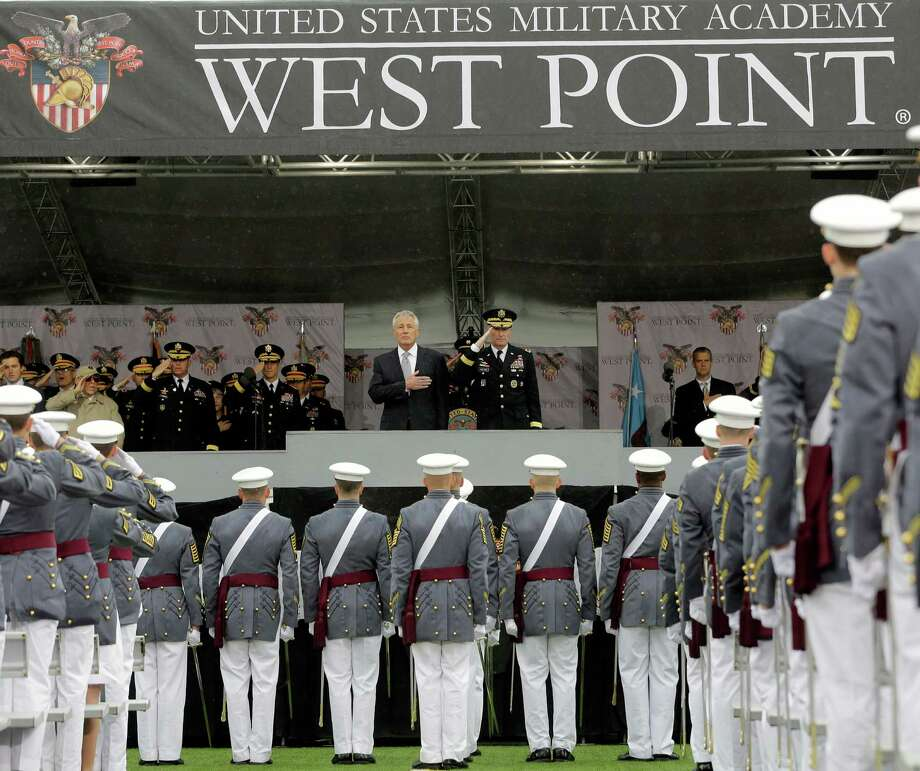 Defense Secretary Chuck Hagel, center left, and Superintendent Lt. Gen. David Huntoon, Jr., center right, stand for the national anthem during a graduation and commissioning ceremony at the U.S. Military Academy in West Point, N.Y. on Saturday, May 25, 2013. (AP Photo/Mike Groll) Photo: Mike Groll