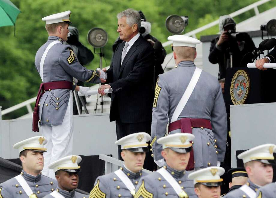 Defense Secretary Chuck Hagel hands diplomas to cadets during a graduation and commissioning ceremony at the U.S. Military Academy in West Point, N.Y. on Saturday, May 25, 2013. (AP Photo/Mike Groll) Photo: Mike Groll