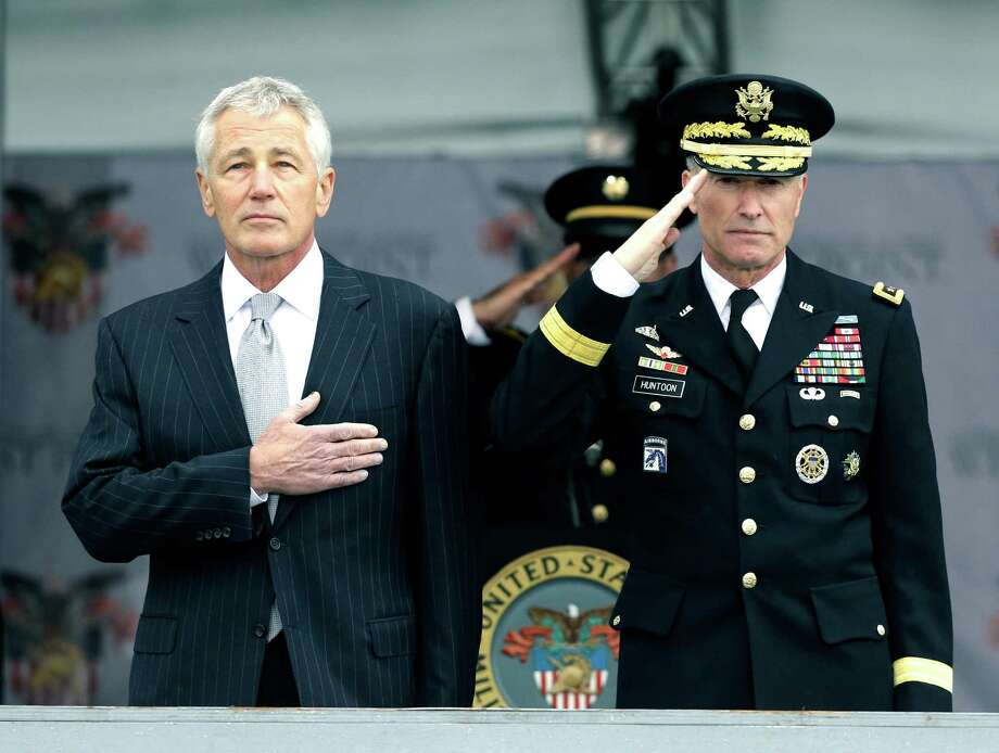 Defense Secretary Chuck Hagel, left, and Superintendent Lt. Gen. David Huntoon, Jr., stand for the national anthem during a graduation and commissioning ceremony at the U.S. Military Academy in West Point, N.Y. on Saturday, May 25, 2013. (AP Photo/Mike Groll) Photo: Mike Groll