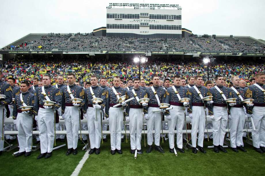 WEST POINT, NY - MAY 25: 2013 graduating cadets recite an oath at the United States Military Academy at West Point (USMA) during the USMA 215 commencement ceremony May 25, 2013 in West Point, New York.  Secretary of Defense Chuck Hagel delivered the commencement speech for the class of 2013. Most USMA graduates are commissioned as second lieutenants in the US Army. Photo: Ramin Talaie, Getty Images / 2013 Getty Images