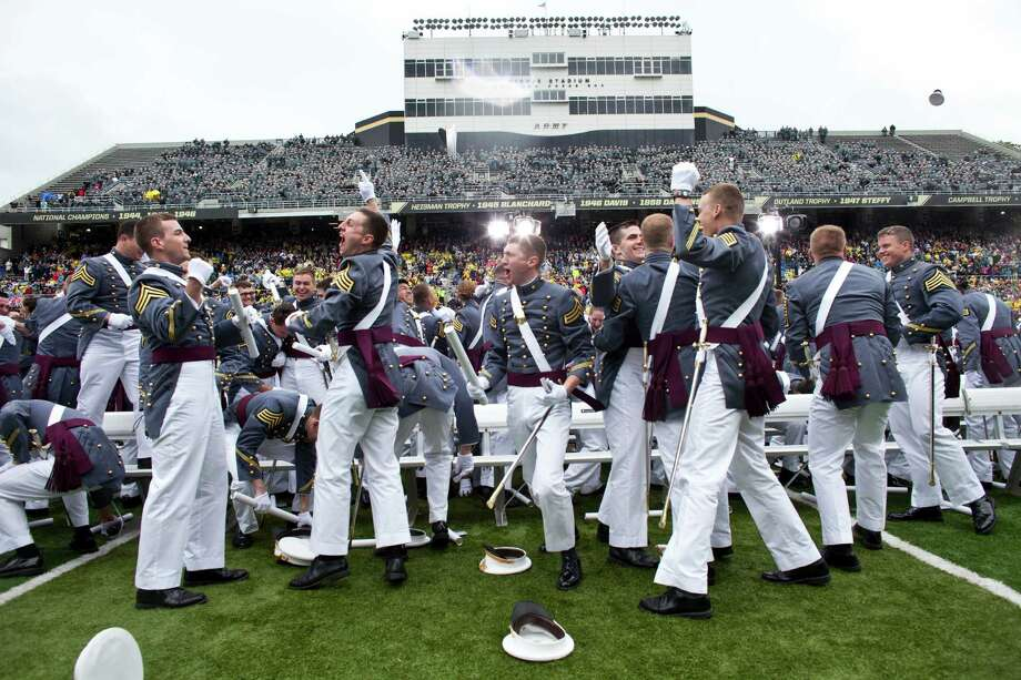 WEST POINT, NY - MAY 25: 2013 graduating cadets celebrate after graduation at the United States Military Academy at West Point (USMA) during the 215 commencement ceremony May 25, 2013 in West Point, New York.  Secretary of Defense Chuck Hagel delivered the commencement speech for the class of 2013. Most USMA graduates are commissioned as second lieutenants in the US Army. Photo: Ramin Talaie, Getty Images / 2013 Getty Images