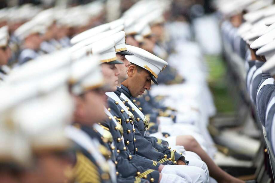 WEST POINT, NY - MAY 25: 2013 graduating cadets listen at the United States Military Academy at West Point (USMA) during the 215 commencement ceremony May 25, 2013 in West Point, New York.  Secretary of Defense Chuck Hagel delivered the commencement speech for the class of 2013. Most USMA graduates are commissioned as second lieutenants in the US Army. Photo: Ramin Talaie, Getty Images / 2013 Getty Images