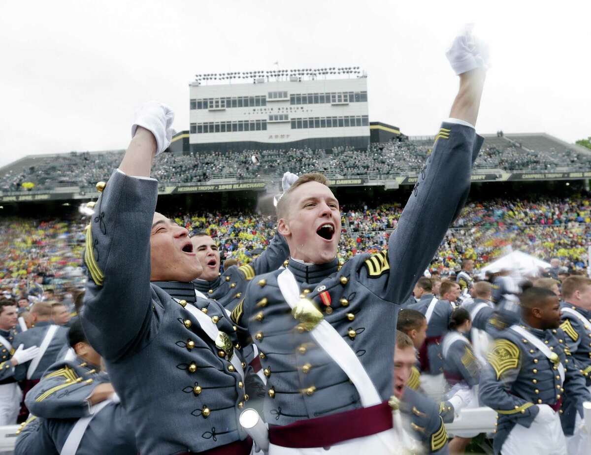 Aaron Lee from Long Island, N.Y., left, and Adam Lowe of Columbia, Md., celebrate after their graduation and commissioning ceremony at the U.S. Military Academy in West Point, N.Y. on Saturday, May 25, 2013.