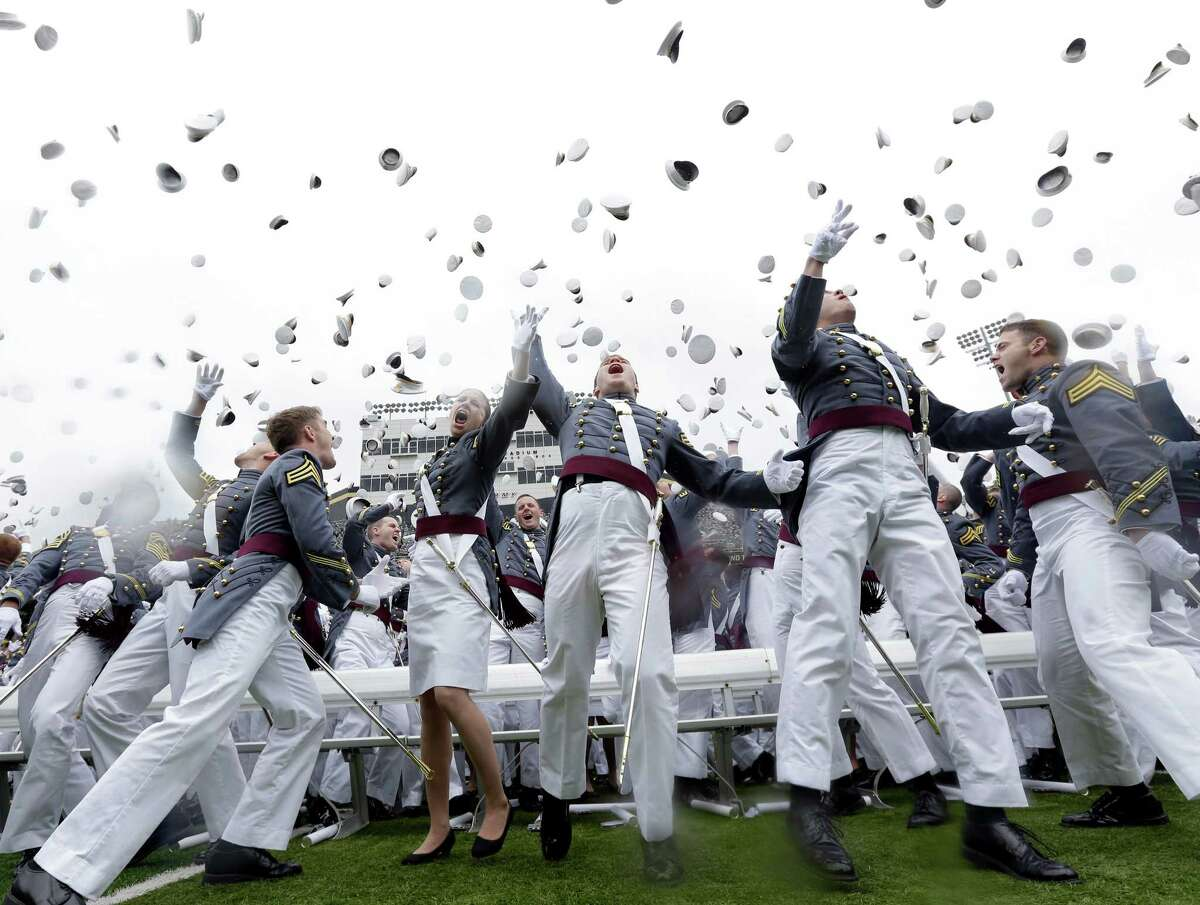 Graduating cadets toss their hats in the air at the end of a graduation and commissioning ceremony at the U.S. Military Academy in West Point, N.Y. on Saturday, May 25, 2013.