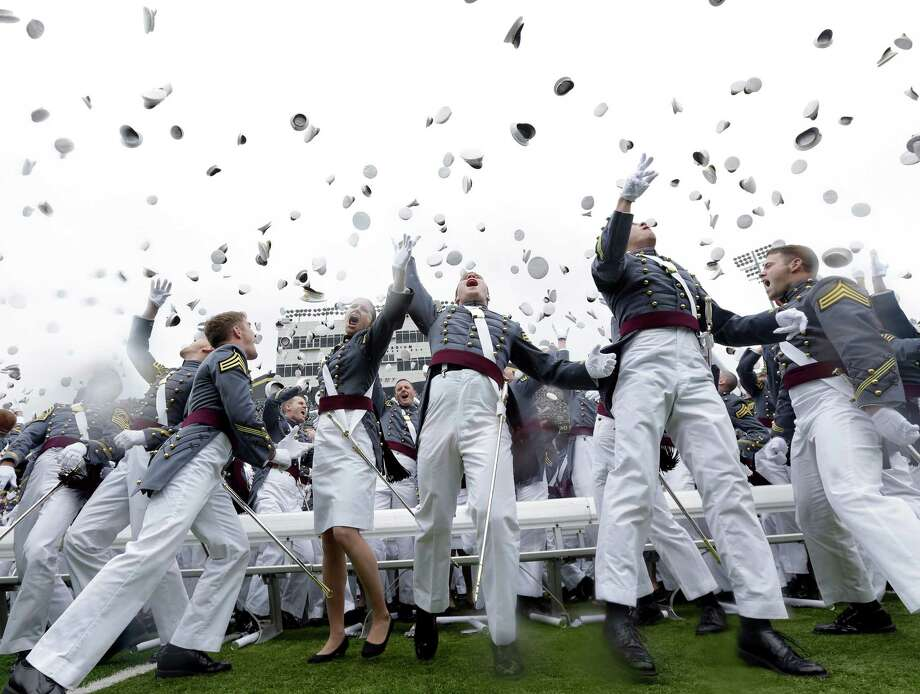 Graduating cadets toss their hats in the air at the end of a graduation and commissioning ceremony at the U.S. Military Academy in West Point, N.Y. on Saturday, May 25, 2013. Photo: Mike Groll, AP / AP