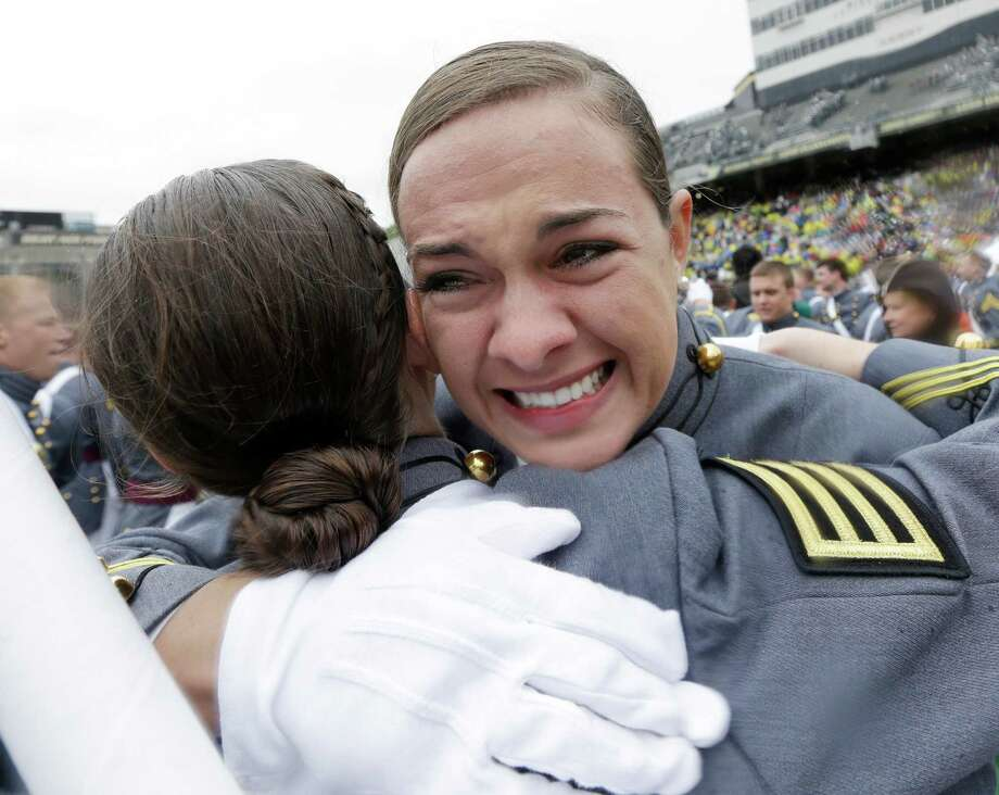 Celina Baldwin of Tampa, Fla. celebrates with a fellow cadet after a graduation and commissioning ceremony at the U.S. Military Academy in West Point, N.Y. on Saturday, May 25, 2013. Photo: Mike Groll, AP / AP