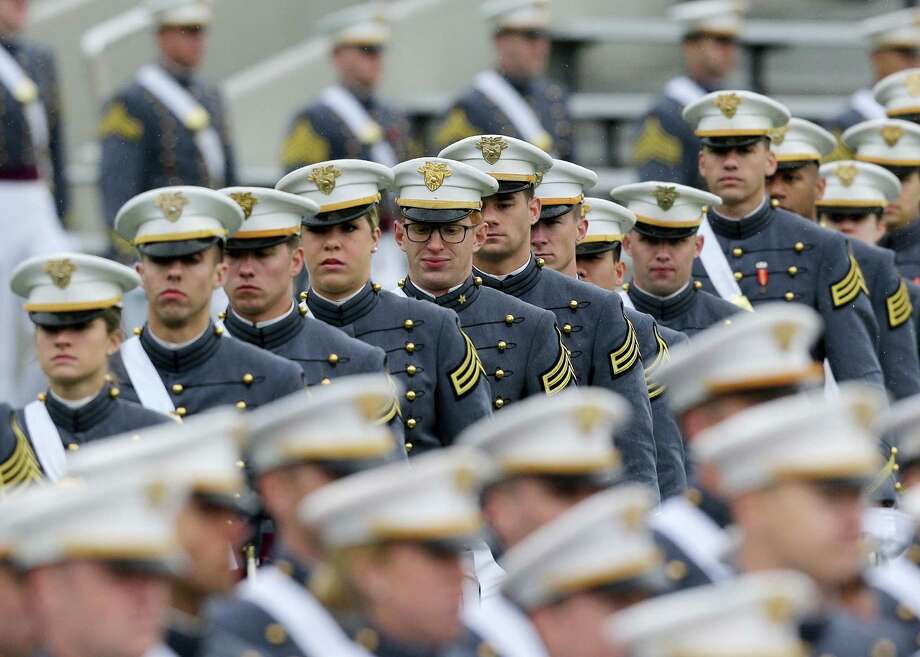 Cadets march into Michie Stadium during a graduation and commissioning ceremony at the U.S. Military Academy in West Point, N.Y. on Saturday, May 25, 2013. Photo: Mike Groll, AP / AP