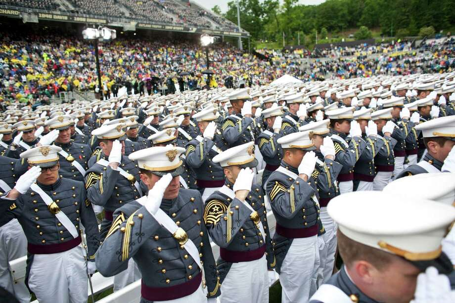 WEST POINT, NY - MAY 25: 2013 graduating cadets stand an salute at the United States Military Academy at West Point (USMA) for the 215 commencement ceremony May 25, 2013 in West Point, New York.  Secretary of Defense Chuck Hagel delivered the commencement speech for the class of 2013. Most USMA graduates are commissioned as second lieutenants in the US Army. Photo: Ramin Talaie, Getty Images / 2013 Getty Images