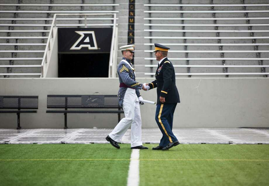 WEST POINT, NY - MAY 25: A 2013 graduating cadet shakes hands with a senior officer after receiving his diploma at the United States Military Academy at West Point (USMA) for the 215 commencement ceremony May 25, 2013 in West Point, New York.  Secretary of Defense Chuck Hagel delivered the commencement speech for the class of 2013. Most USMA graduates are commissioned as second lieutenants in the US Army. Photo: Ramin Talaie, Getty Images / 2013 Getty Images