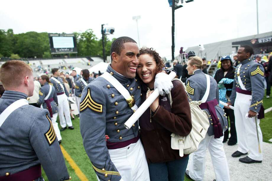 WEST POINT, NY - MAY 25: 2013 graduating cadet celebrates after graduation at the United States Military Academy at West Point (USMA) during the 215 commencement ceremony May 25, 2013 in West Point, New York.  Secretary of Defense Chuck Hagel delivered the commencement speech for the class of 2013. Most USMA graduates are commissioned as second lieutenants in the US Army. Photo: Ramin Talaie, Getty Images / 2013 Getty Images