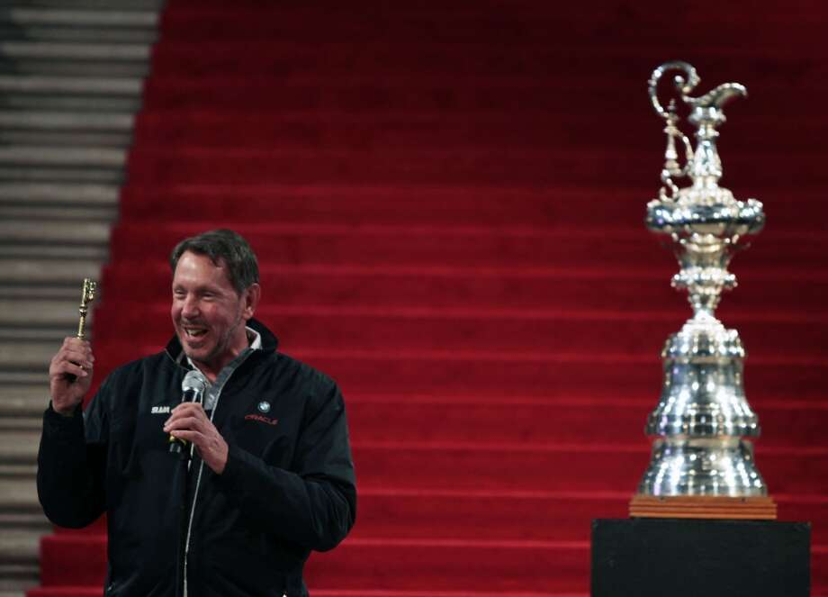 Larry Ellison owner of BMW Oracle Racing team holds up a key to the city presented to him by San Francisco Mayor Gavin Newsom during a ceremony at San Francisco City Hall. Ellison and his team won the 33rd America's Cup in Spain as representatives of The Golden Gate Yacht Club.