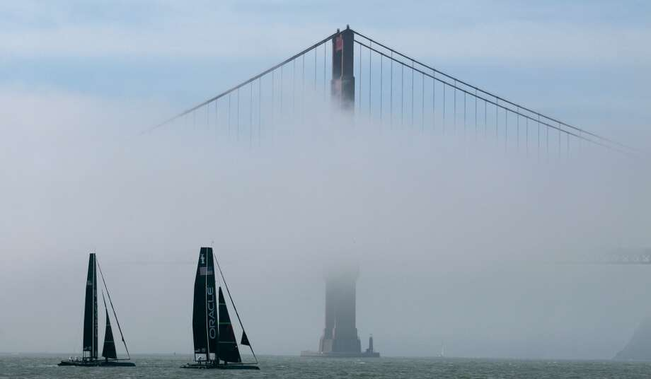 A pair of Oracle Racing AC45s sail past the Golden Gate Bridge in San Francisco, Tuesday, Feb. 21, 2012.