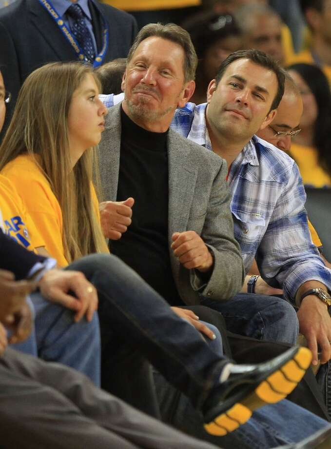 CEO of Oracle Larry Ellison looks on during the Golden State Warriors and the Denver Nuggets Game Six of the Western Conference Quarterfinals of the 2013 NBA Playoffs at ORACLE Arena on May 2, 2013 in Oakland, California.