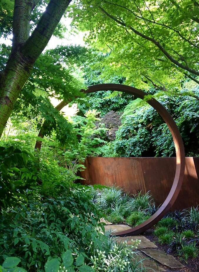 A moon gate and a retaining wall are fashioned from Cor-Ten in this Kentfield garden by Davis Dalbok and Tim O'Shea. Photo: Davis Dalbok/Living Green