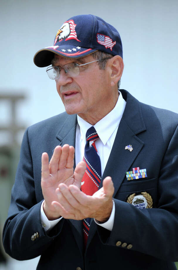 John Valluzzo, of Ridgefield, founder and president of the Southern New England Military Museum in Danbury, applauds speakers at a ceremony that brought pieces of steel from the World Trade Center to the museum's display. Photo taken Tuesday, June 28, 2011. Photo: Carol Kaliff, ST / The News-Times