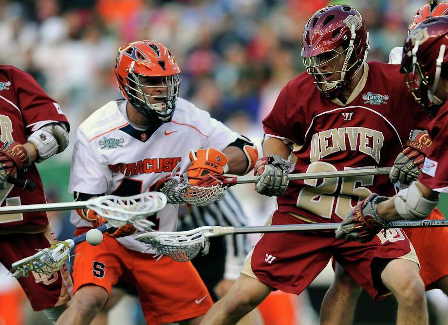 Denver's Garret Holst (25) reaches for a loose ball in front of Syracuse's Cal Paduda (41) during the first half of an NCAA college Division 1 semifinal lacrosse game on Saturday, May 25, 2013, in Philadelphia. Photo: Michael Perez