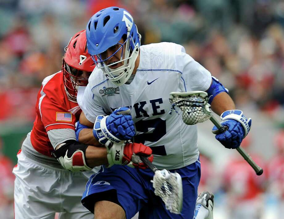 Duke's Greg DeLuca, right, drives past Cornell's Connor Buczek during the first half of an NCAA division 1 semifinal lacrosse game on Saturday, May 25, 2013, in Philadelphia. Photo: Michael Perez