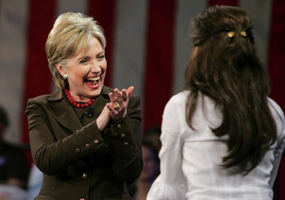 Democratic presidential hopeful, Sen. Hillary Rodham Clinton, D-N.Y, greets  Eva Longoria on stage as she makes a campaign stop at the Austin Convention Center in Austin, Texas, Monday, March 3, 2008. Photo: Carolyn Kaster, AP / AP