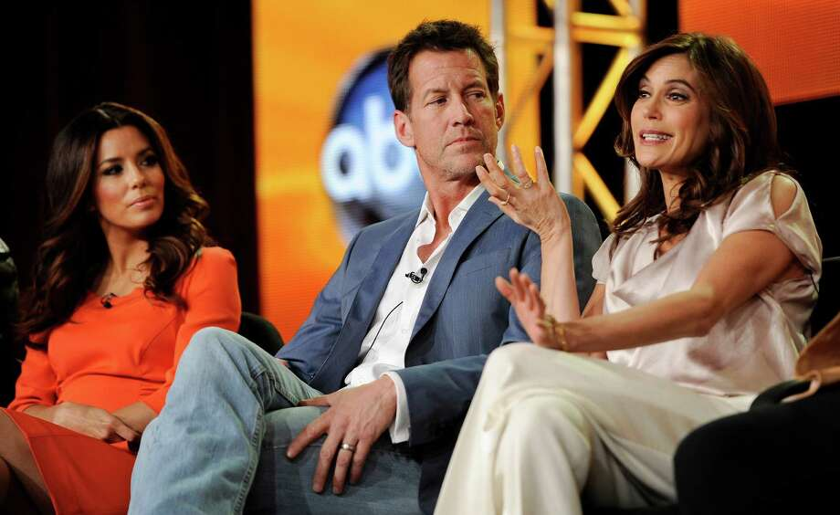 "Teri Hatcher, right, a cast member in the ABC series ""Desperate Housewives,"" answers a reporter's question as fellow cast members James Denton, center, and Eva Longoria look on at the Disney ABC Television Critics Association Press Tour, Tuesday, Jan. 10, 2012, in Pasadena, Calif. Denton was a surrogate for John Edwards campaign in 2008. Photo: Chris Pizzello, Associated Press / AP"