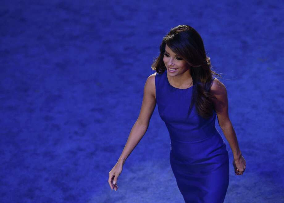 Obama Campaign Co-Chair Eva Longoria leaves the stage after speaking to the audience at the Time Warner Cable Arena in Charlotte, North Carolina, on September 6, 2012 on the final day of the Democratic National Convention (DNC). US President Barack Obama is expected to accept the nomination from the DNC to run for a second term as president. Photo: BRENDAN SMIALOWSKI, AFP/Getty Images / AFP