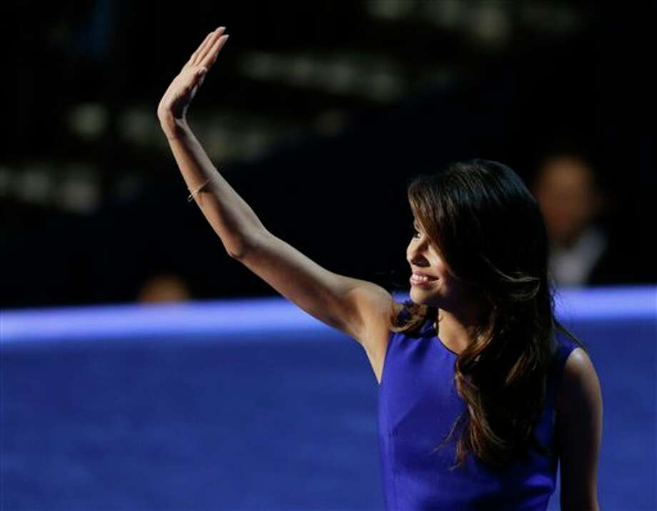 Obama Campaign Co-Chair Eva Longoria waves to delegates at the Democratic National Convention in Charlotte, N.C., on Thursday, Sept. 6, 2012. Photo: Lynne Sladky, AP / AP