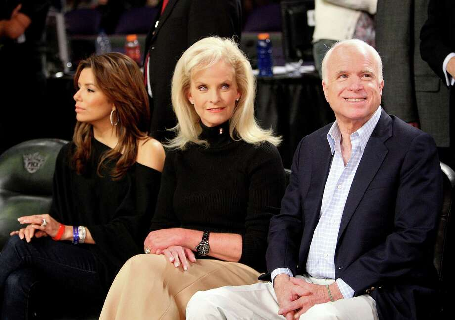 (L-R) Actress Eva Longoria Parker, Cindy McCain, and senator John McCain pose in the audience during the 58th NBA All-Star Game, part of 2009 NBA All-Star Weekend at US Airways Center on February 15, 2009 in Phoenix, Arizona. Photo: Jason Merritt, Getty Images / Getty Images North America