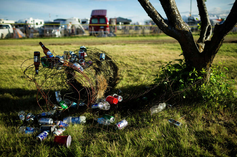 An array of discarded alcohol bottles adorn a section of tangled wire near the entrance of the Sasquatch music festival Saturday, May 25, 2013, at The Gorge Amphitheatre in George. Photo: JORDAN STEAD, SEATTLEPI.COM / SEATTLEPI.COM